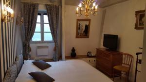 Un ou plusieurs lits dans un hébergement de l'établissement Château de Salles