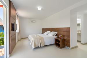 A bed or beds in a room at Atlântida Park Hotel