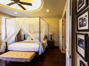 Giường trong phòng chung tại Villa Song Saigon