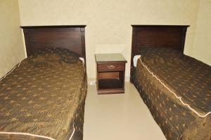 Cama ou camas em um quarto em Golden Prince Hotel Al Fayizia