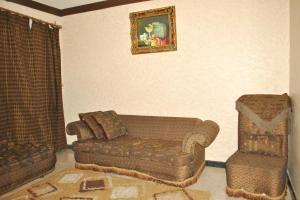 Uma área de estar em Golden Prince Hotel Al Fayizia