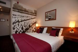 Letto o letti in una camera di Hotel Restaurant & Casino De Nachtegaal