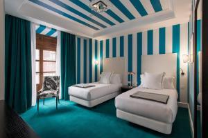 Гостиная зона в Room Mate Valeria