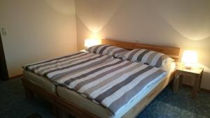 Ein Bett oder Betten in einem Zimmer der Unterkunft Gästehaus Steinmetz