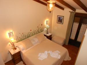 Cama o camas de una habitación en Casa Rural La Fresneda