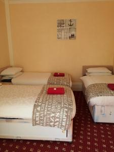A bed or beds in a room at Park Inn Hotel Folkestone