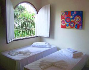 A bed or beds in a room at Cosmopolitan Hostel