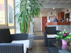 The lobby or reception area at Best Hôtel Lille