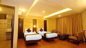 A bed or beds in a room at Kathmandu Grand Hotel