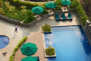 A view of the pool at Conrad Pune Koregaon Park by Hilton or nearby