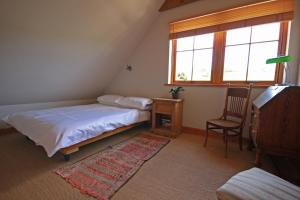 A bed or beds in a room at Netherton Farm B&B