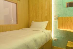 Ein Bett oder Betten in einem Zimmer der Unterkunft Boxtel @ Suvarnabhumi Airport
