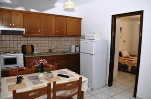 Η κουζίνα ή μικρή κουζίνα στο Lea Family Resort