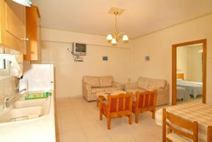 A seating area at Sagittarius Apartments