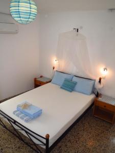 Un ou plusieurs lits dans un hébergement de l'établissement Vivian Studios