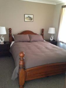 A bed or beds in a room at Lavendale Farmstay and Cottages York
