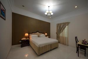 Ein Bett oder Betten in einem Zimmer der Unterkunft Royal Residence Hotel Apartments