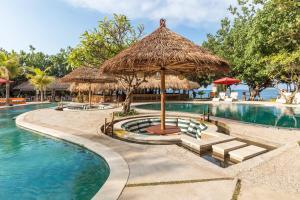 The swimming pool at or near Taman Sari Bali Resort and Spa