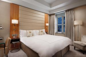 A bed or beds in a room at Conrad London St James