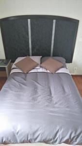 Un ou plusieurs lits dans un hébergement de l'établissement Chez Maxim