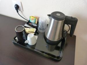 Coffee and tea-making facilities at Central Hotel Cayenne