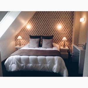 Ein Bett oder Betten in einem Zimmer der Unterkunft Relais Du Vignoble