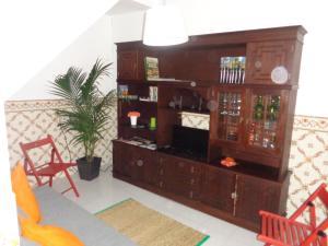 A television and/or entertainment center at Casa da Turquinia