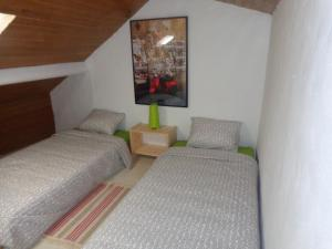 A bed or beds in a room at Casa da Turquinia