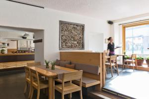 A restaurant or other place to eat at Stadthotel Brunner