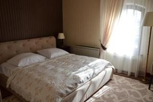 Łóżko lub łóżka w pokoju w obiekcie Hotel Nowodworski