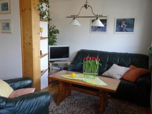 Ein Sitzbereich in der Unterkunft Ferienwohnung Panorama