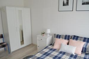 Łóżko lub łóżka w pokoju w obiekcie Apartament BAIGO