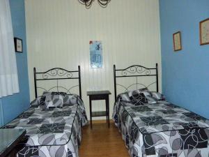 Cama o camas de una habitación en Hotel de la Val