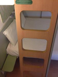 A bunk bed or bunk beds in a room at Ibis Budget Rambouillet