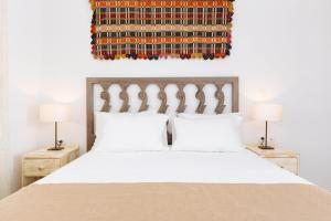 Een bed of bedden in een kamer bij Silene Villas