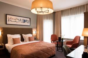 Кровать или кровати в номере Hotel Aragon