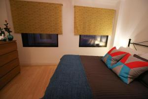 A bed or beds in a room at Prestige Apartments The City Monument