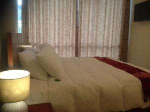 A bed or beds in a room at Casa Real Hoteles