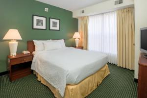 A bed or beds in a room at Residence Inn by Marriott Oklahoma City South