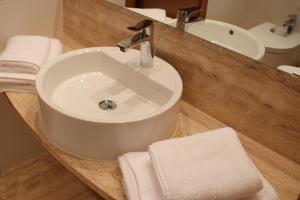 Een badkamer bij Aparthotel Golf Beach
