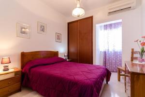 A bed or beds in a room at Armação de Pêra Villa Hedwiges