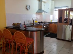 A kitchen or kitchenette at Apartment Ocean Side