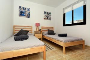 A bed or beds in a room at Jarenal Close to the Beach Guacimeta