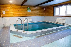 The swimming pool at or near Eco Hotel Berezovaya Roscha