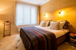 A bed or beds in a room at Aplace Antwerp boutique flats & hotel rooms
