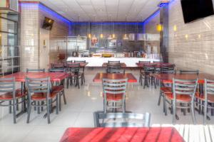 A restaurant or other place to eat at LIC Hotel
