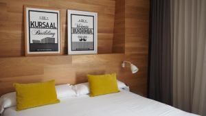 Cama o camas de una habitación en Zenit San Sebastián
