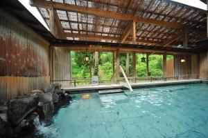 Het zwembad bij of vlak bij Ginzanso