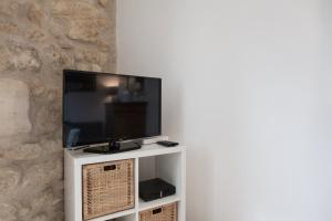 A television and/or entertainment center at Augustins