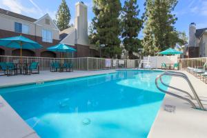 The swimming pool at or near Residence Inn Bakersfield